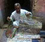 "Pictures ... Artist from Qena makes carpets ""handicrafts"" from sweets bags using ""loom"""